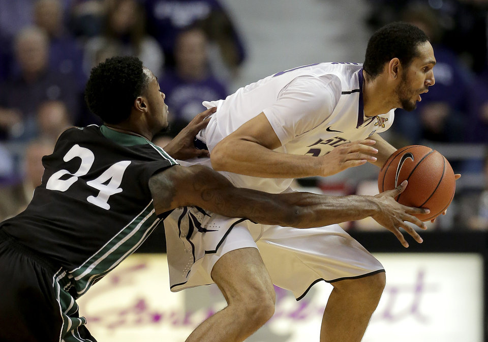 Photo - Kansas State forward Adrian Diaz, right, steals the ball away from South Carolina Upstate forward Jodd Maxey (24) during the first half of an NCAA college basketball game on Sunday, Dec. 2, 2012, in Manhattan, Kan. (AP Photo/Charlie Riedel)