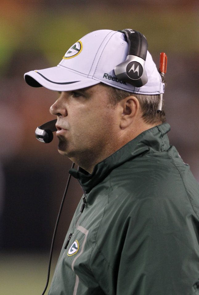 Photo - Green Bay Packers head coach Mike McCarthy watches from the sidelines during the second quarter of a preseason NFL football game against the Cleveland Browns, Saturday, Aug. 13, 2011, in Cleveland. (AP Photo/Mark Duncan) ORG XMIT: OHMD102