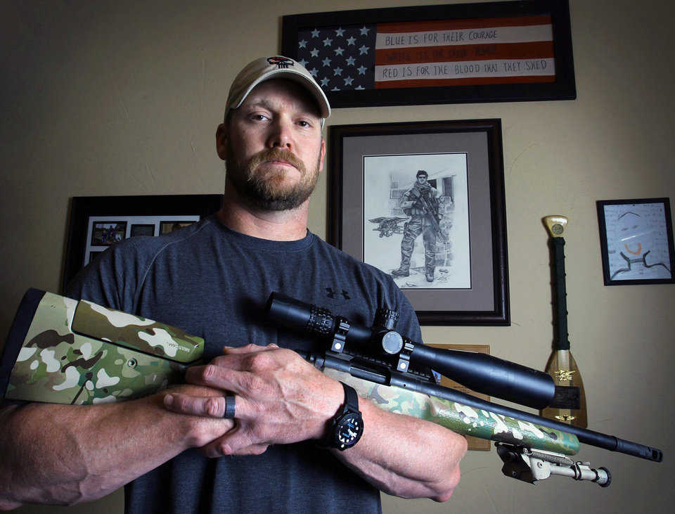 FILE - In this April 6, 2012 file photo, Chris Kyle, a former Navy SEAL and author of the book �American Sniper,� poses in Midlothian, Texas. Kyle and his friend Chad Littlefield were fatally shot at a shooting range southwest of Fort Worth, Texas, on Saturday, Feb. 2, 2013. Former Marine Eddie Ray Routh, who came with them to the range, has been arrested for the murders. (AP Photo/The Fort Worth Star-Telegram, Paul Moseley, File)