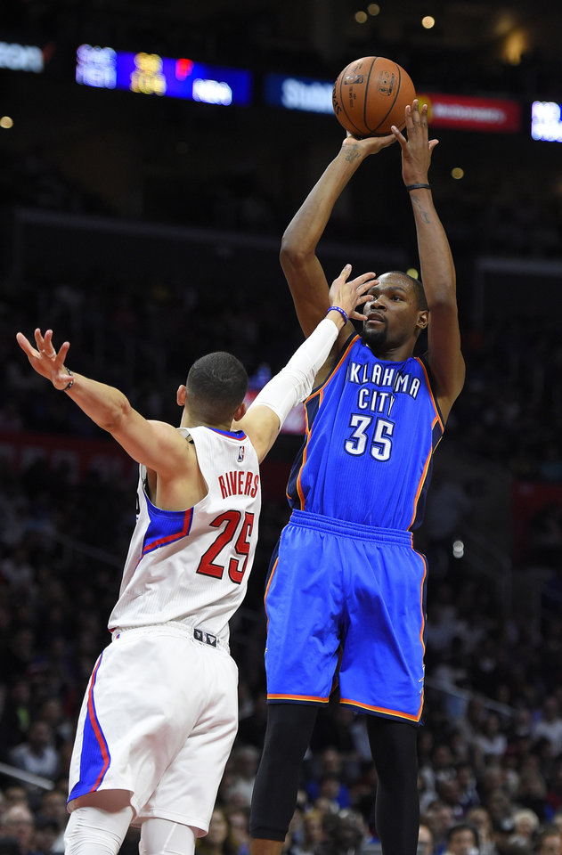 Photo - Oklahoma City Thunder forward Kevin Durant, right, shoots as Los Angeles Clippers guard Austin Rivers defends during the second half of an NBA basketball game, Wednesday, March 2, 2016, in Los Angeles. The Clippers won 103-98. AP Photo/Mark J. Terrill)