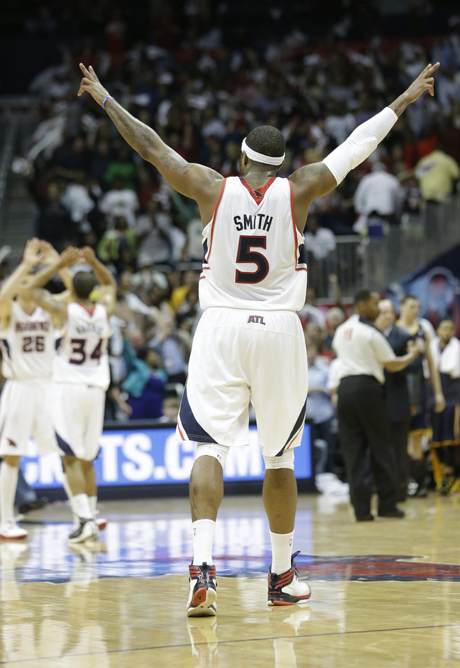 Photo - Atlanta Hawks small forward Josh Smith (5) reacts in the closing seconds during the second half in Game 4 of their first-round NBA basketball playoff series game against the Indiana Pacers, Monday, April 29, 2013 in Atlanta. Atlanta won 102-91 to even the series at 2-2. (AP Photo/John Bazemore)