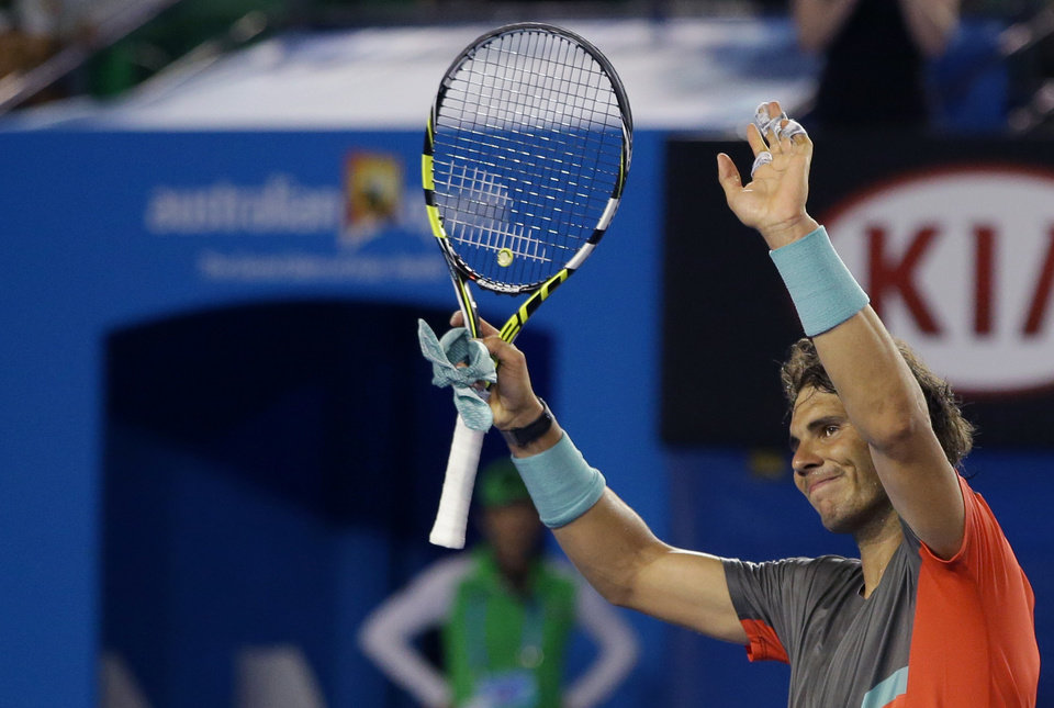 Photo - Rafael Nadal of Spain celebrates after defeating Thanasi Kokkinakis of Australia in their second round match at the Australian Open tennis championship in Melbourne, Australia, Thursday, Jan. 16, 2014.(AP Photo/Aaron Favila)