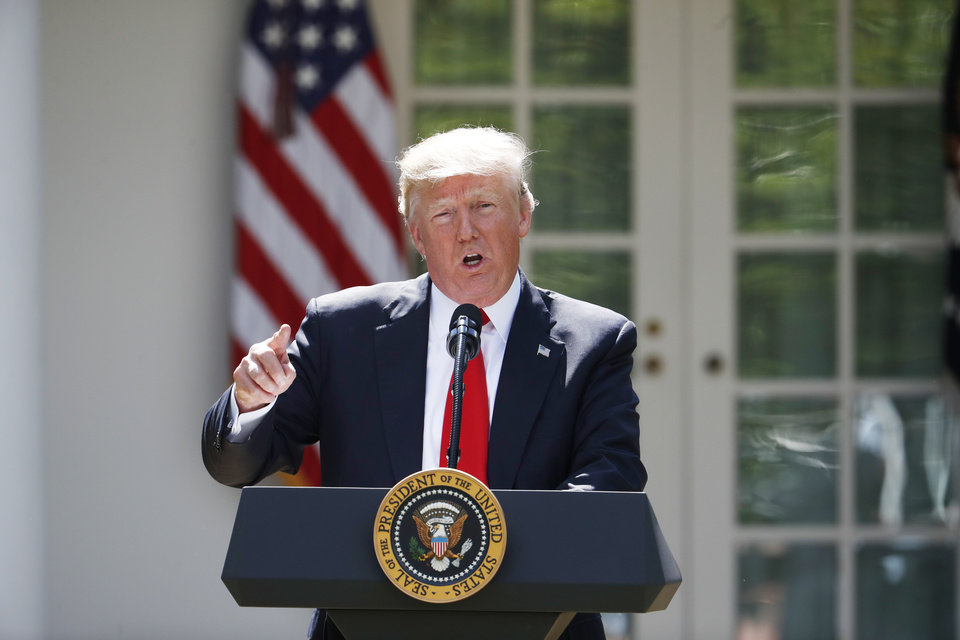 Photo - President Donald Trump speaks about the U.S. role in the Paris climate change accord. (AP Photo/Pablo Martinez Monsivais)