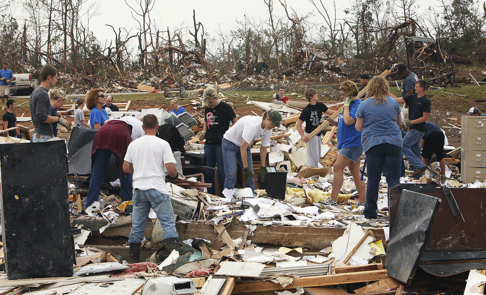 Students, teachers and administrators sieved through the debris of the Little Axe School Central Office, Tuesday, May 11, 2010. The school was hit by a tornado Monday, May 10, 2010. Photo by David McDaniel, The Oklahoman