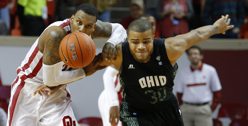 Photo - Oklahoma's Romero Osby (24) and Ohio's Reggie Keely (30) for for a loose ball during a NCAA college basketball game between the University of Oklahoma (OU) and Ohio at the Lloyd Noble Center in Norman, Saturday, Dec. 29, 2012. Oklahoma won 74-63. Photo by Bryan Terry, The Oklahoman