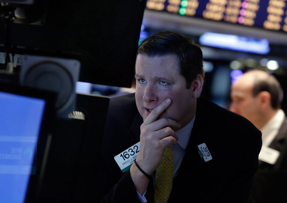 Photo - Specialist Gregg Maloney works on the floor of the New York Stock Exchange, Monday, March 3, 2014. Global stock markets are down sharply on tensions over Russia's military advance into Ukraine and the threat of sanctions by Western governments. (AP Photo/Richard Drew)