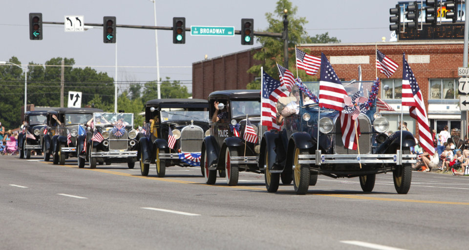 The Okie A\'s Model A club turns out for the annual LibertyFest Fourth of July Parade in downtown Edmond, OK, Thursday, July 4, 2013, Photo by Paul Hellstern, The Oklahoman