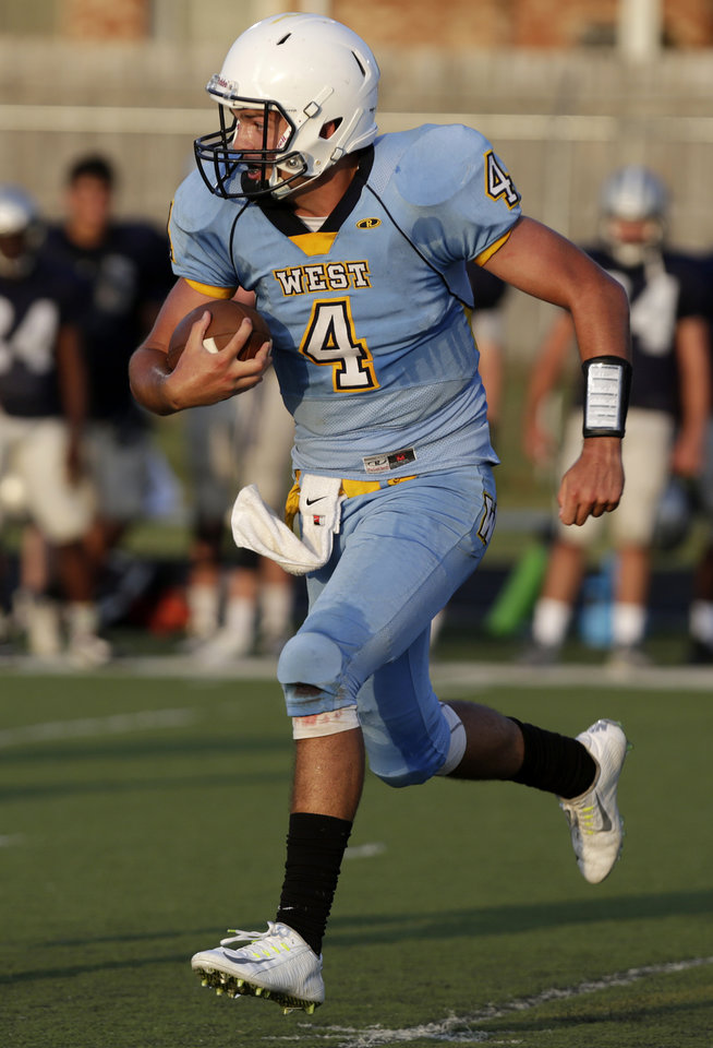 Photo - Putnam City West's Trey Gooch (4) runs the ball during a scrimmage at Putnam City West High School in Bethany, Thursday, Aug. 21, 2014.  Photo by Garett Fisbeck, For The Oklahoman