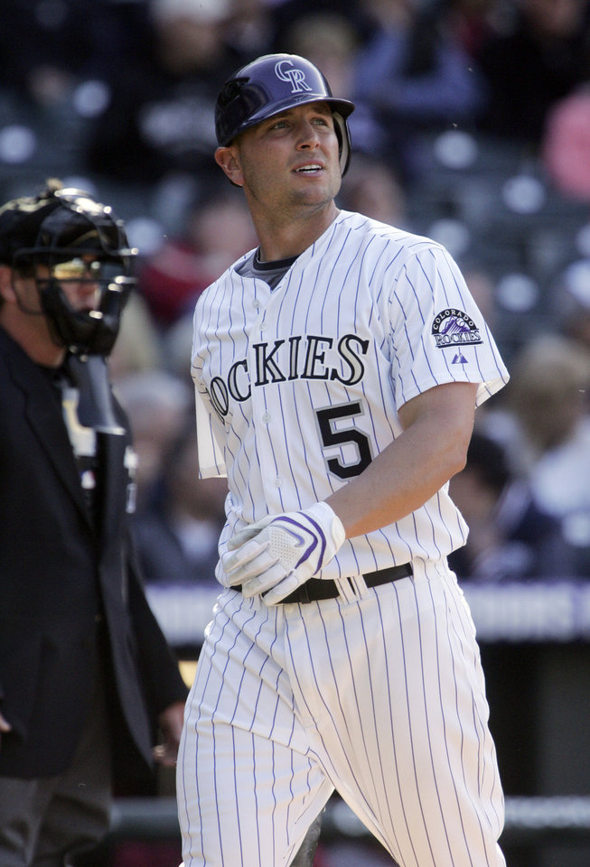 Photo - Colorado Rockies' Matt Holliday looks to the stands after striking out in the ninth inning against the Arizona Diamondbacks during a baseball game in Denver, Friday, April 4, 2008. (AP Photo/Jack Dempsey) ORG XMIT: DXF113