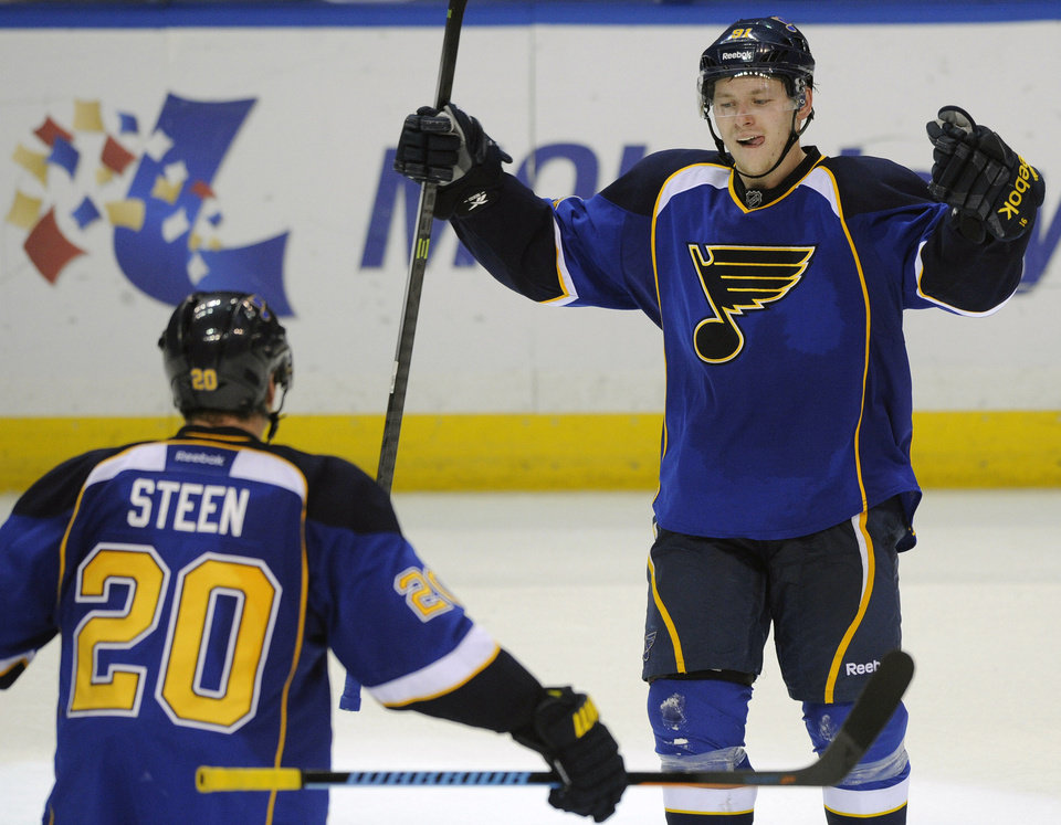 Photo - St. Louis Blues' Vladimir Tarasenko (91), of Russia, celebrates with teammate Alexander Steen (20) after his game-tying goal against the Chicago Blackhawks during the third period in Game 2 of a first-round NHL hockey playoff series, Saturday, April 19, 2014, in St. Louis. (AP Photo/Bill Boyce)