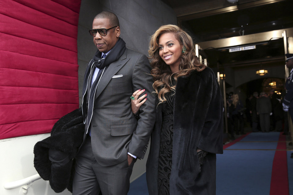 Recording artists Jay-Z and Beyonce arrive on the West Front of the Capitol in Washington, Monday, Jan. 21, 2013, for the Presidential Barack Obama\'s ceremonial swearing-in ceremony during the 57th Presidential Inauguration. (AP Photo/Win McNamee, Pool)