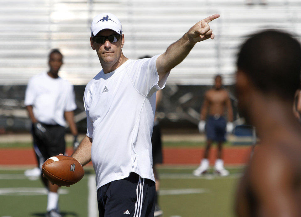 Photo - Edmond North football coach Scott Burger instructs players during a skills camp in Edmond, Wednesday June 12, 2013. Photo By Steve Gooch, The Oklahoman  Steve Gooch - The Oklahoman