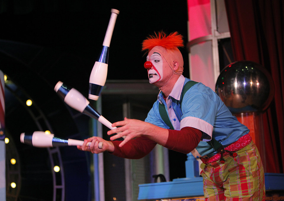 Photo - Jordan Bunce juggles during a Science Live show at Science Museum Oklahoma. Ringling Bros. and Barnum & Bailey clowns showed viewers the science behind circus performance. Photos by Garett Fisbeck, The Oklahoman