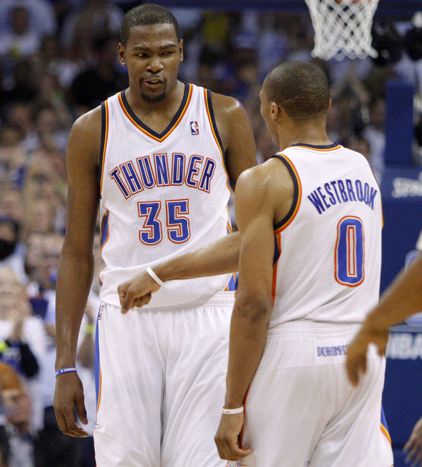 Photo - Oklahoma City's Kevin Durant (35) and Russell Westbrook (0) react during Game 4 of the Western Conference Finals between the Oklahoma City Thunder and the San Antonio Spurs in the NBA playoffs at the Chesapeake Energy Arena in Oklahoma City, Saturday, June 2, 2012. Oklahoma CIty won 109-103. Photo by Bryan Terry, The Oklahoman