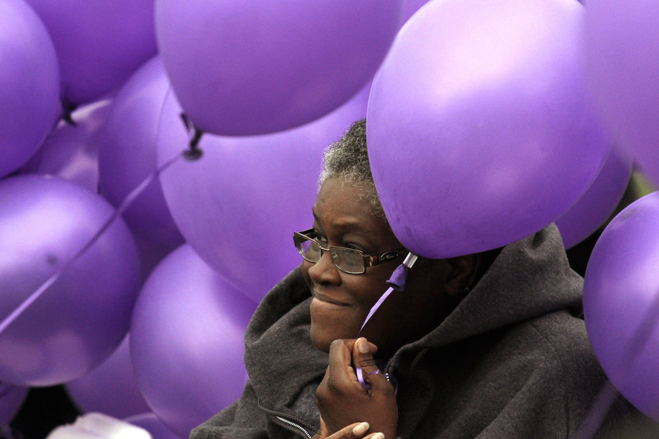Willie Dykes is surrounded by purple balloons during a ceremony to remember victims of domestic violence at the Capitol in Oklahoma City, Thursday, October 4, 2012.  Photo by Doug Hoke, The Oklahoman