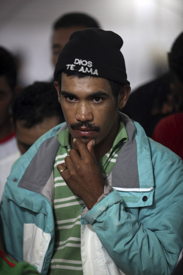 Photo - A migrant from Honduras who survived a train derailment pauses at an improvised temporary migrant shelter in Las Choapas, southern Mexico, Sunday Aug. 25, 2013. The cargo train, known as