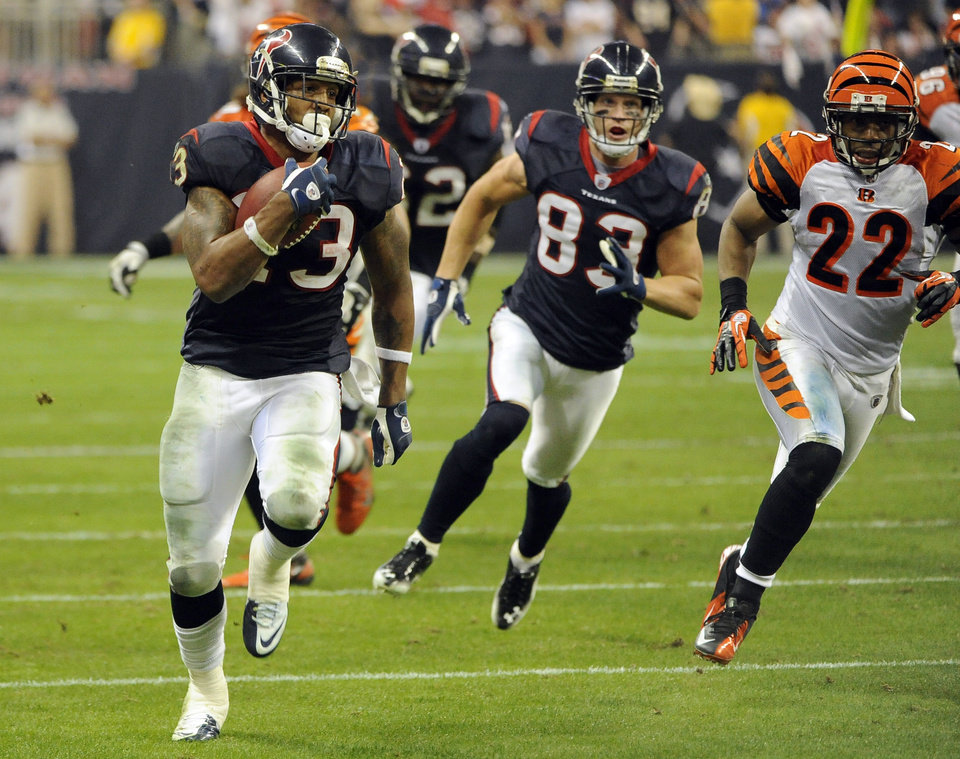 Photo - Houston Texans running back Arian Foster (23) runs for a touchdown against the Cincinnati Bengals during the fourth quarter of an NFL wild card playoff football game Saturday, Jan. 7, 2012, in Houston. (AP Photo/Dave Einsel) ORG XMIT: HTT213