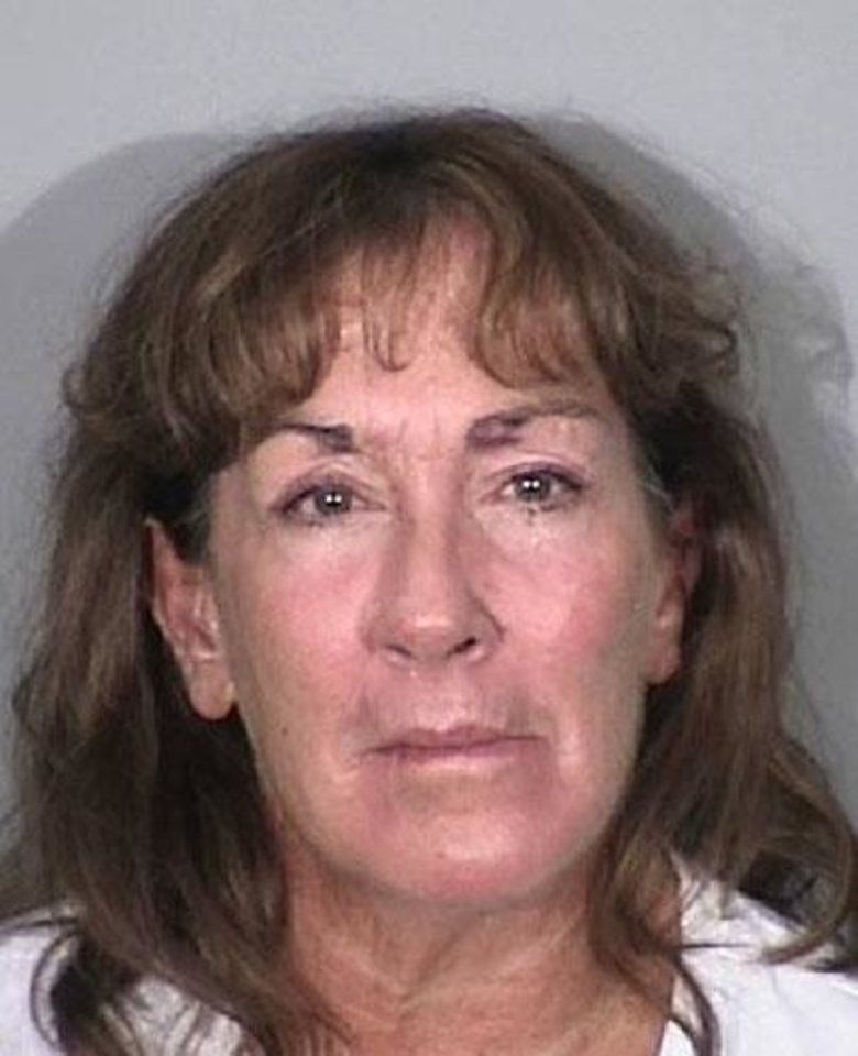 This undated booking photo provided by the Torrance Police Dept., Sherri Wilkins is shown. Wilkins, a substance abuse counselor was charged with murder and drunken-driving Tuesday, Nov. 27, 2012, after authorities said she struck a pedestrian and drove for more than two miles with the dying victim embedded in the windshield of her car. Wilkins, 51, was also charged with gross vehicular manslaughter while intoxicated and leaving the scene of an accident, the district attorney's office said in a statement. The victim, 31-year-old Phillip Moreno, was struck late Saturday while crossing a street. Witnesses surrounded the car about two miles later and detained Wilkins. Moreno died at a hospital. (AP Photo/Torrance Police Dept.)