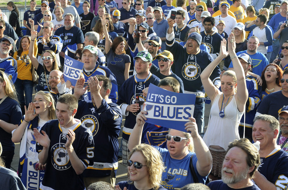 Photo - St. Louis Blues fans cheer prior to Game 1 of the Blues' first-round NHL hockey Stanley Cup playoff series against the Los Angeles Kings, Tuesday, April 30, 2013, in St. Louis. (AP Photo/Bill Boyce)