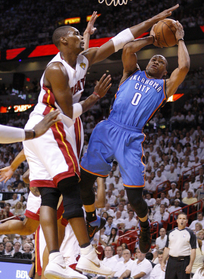 Photo - Oklahoma City's Russell Westbrook (0) goes to the basket beside Miami's Chris Bosh (1) during Game 5 of the NBA Finals between the Oklahoma City Thunder and the Miami Heat at American Airlines Arena, Thursday, June 21, 2012. Photo by Bryan Terry, The Oklahoman