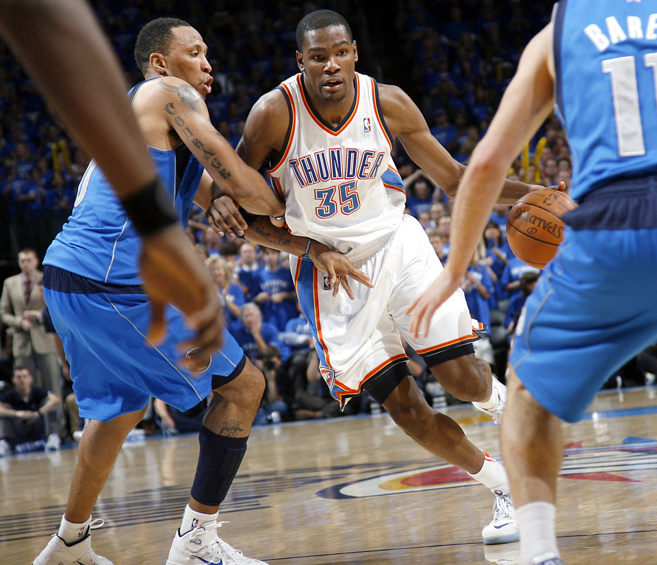 Photo - Oklahoma City's Kevin Durant (35) dribbles past pressure from Shawn Marion (0) and other Dallas defenders during game 4 of the Western Conference Finals in the NBA basketball playoffs between the Dallas Mavericks and the Oklahoma City Thunder at the Oklahoma City Arena in downtown Oklahoma City, Monday, May 23, 2011. The Thunder lost game 3 to the Mavericks 112-105. Photo by John Clanton, The Oklahoman