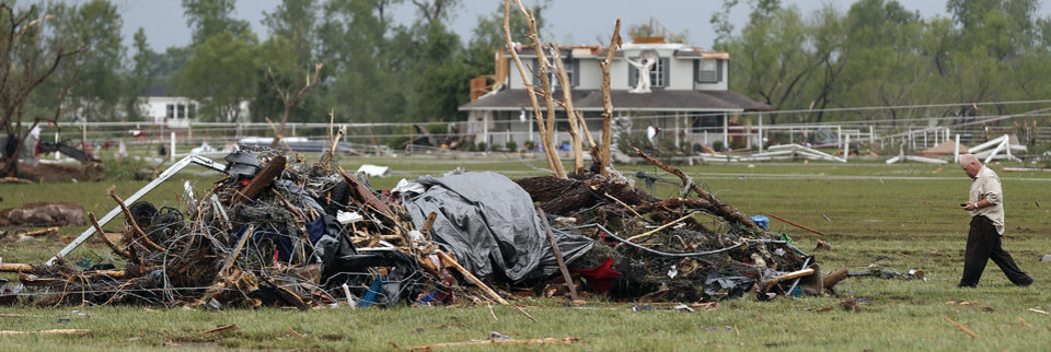 Chris Shelley looks for items from his home that was destroyed by a tornado that hit the area near 149th and Drexel on Monday, May 20, 2013 in Oklahoma City, Okla.  Photo by Chris Landsberger, The Oklahoman