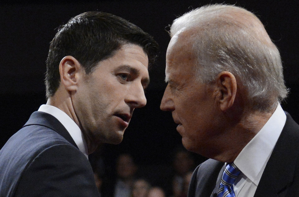 Vice President Joe Biden and Republican vice presidential nominee Rep. Paul Ryan of Wisconsin shake hands after the vice presidential debate at Centre College, Thursday, Oct. 11, 2012, in Danville, Ky. (AP Photo/Pool-Michael Reynolds)