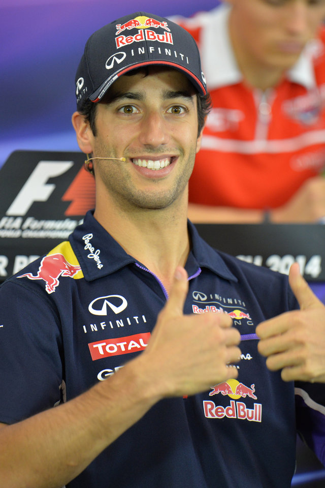 Photo - Red Bull driver Daniel Ricciardo of Australia gesticulates during a press conference in Spielberg,  Austria, Thursday, June 19, 2014. The Austria Formula One Grand Prix will be held on Sunday. (AP Photo/Kerstin Joensson)