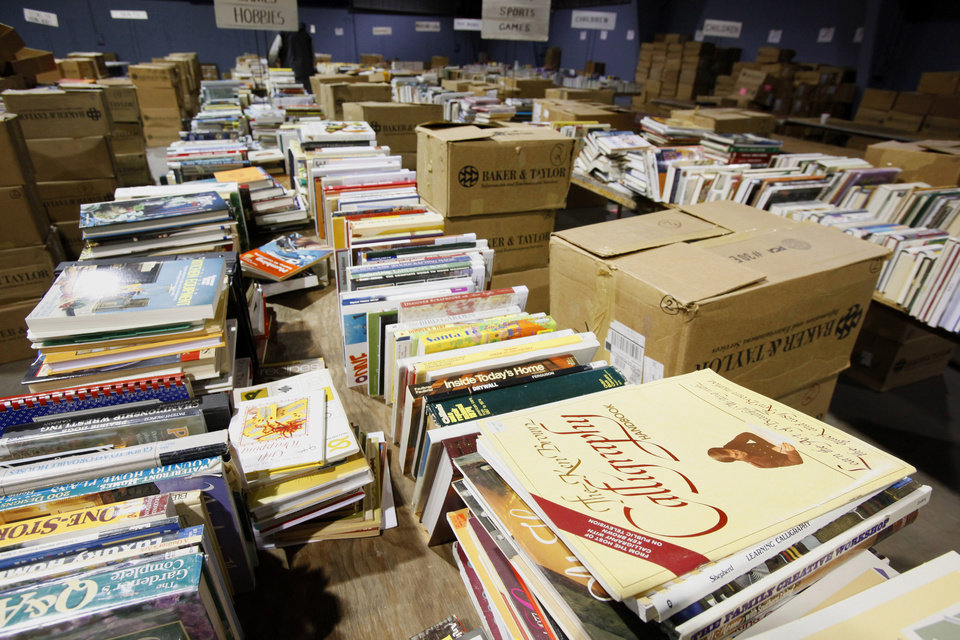 Books stacked on tables Tuesday, Feb. 16, 2010, in the hobbies, games and sports section for the annual Friends of the Library book sale this weekend in Oklahoma City. Photo by Paul B. Southerland, The Oklahoman