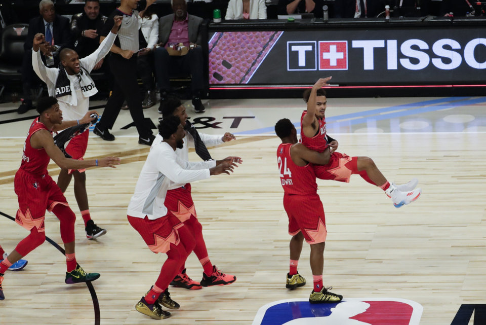 Photo - Trae Young of the Atlanta Hawks celebrates after makingf a three-point basket during the first half of the NBA All-Star basketball game Sunday, Feb. 16, 2020, in Chicago. (AP Photo/David Banks)