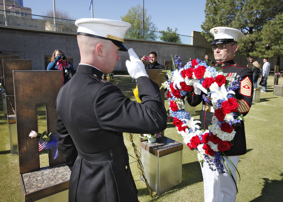 Marines place a wreath between the chairs of Sgt. Benjamin LaRanzo Davis and Capt. Randolph Guzman before the 18th Anniversary Remembrance Ceremony at the Oklahoma City National Memorial and Museum, Friday, April 19, 2013. Photo By David McDaniel/The Oklahoman