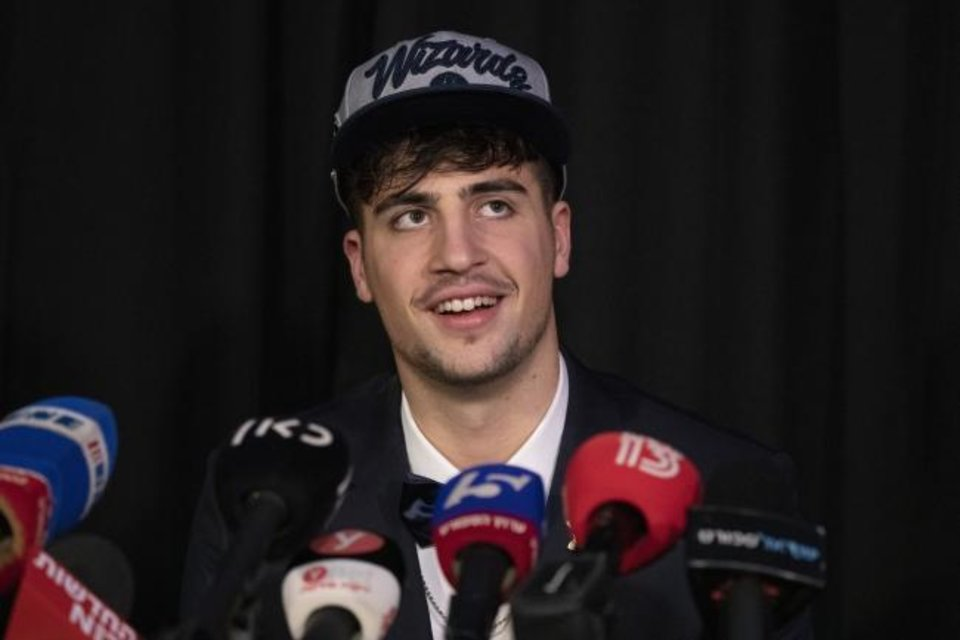 Photo -  Deni Avdija speaks to media members Thursday in Tel Aviv, Israel. Avdija was selected by the Washington Wizards with the No. 9 overall pick in the NBA Draft on Wednesday. [AP Photo/Ariel Schalit]