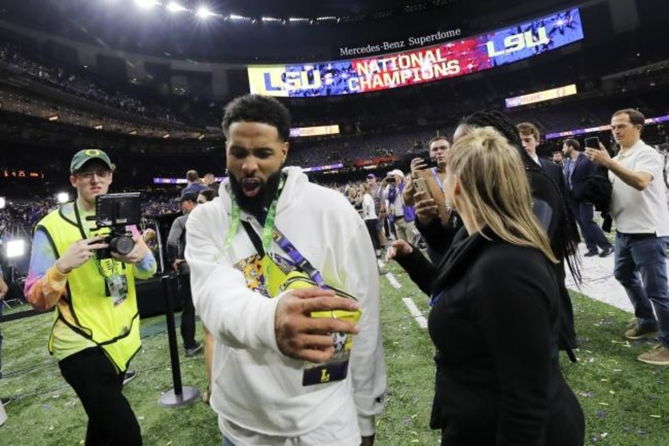 Photo -  Former LSU star Odell Beckham Jr. walks off the field after the national championship game last week. [AP Photo/Gerald Herbert]