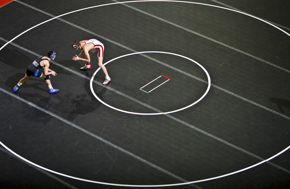 Blake Lawson of Choctaw and Nick Haugen of Claremore take to the mat in the Class 6A 145 pound match during the 90th annual Oklahoma High School state wrestling tournament on Friday, Feb. 25, 2011, in Oklahoma City, Okla.  Photo by Chris Landsberger, The Oklahoman