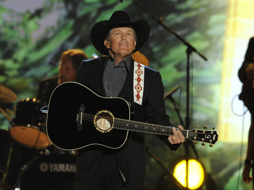 Photo - FILE - In this April 7, 2013 file photo, singer George Strait performs at the 48th Annual Academy of Country Music Awards at the MGM Grand Garden Arena in Las Vegas. The 2014 Academy of Country Music Awards in Las Vegas will air live Sunday night, April 6, 2014, from 8-11 p.m. EDT on CBS. Several awards, including top honor entertainer of the year, will be announced during the broadcast, to be hosted by Blake Shelton and Luke Bryan. Shelton, Bryan, George Strait, Miranda Lambert, Jason Aldean, Keith Urban, Tim McGraw, Shakira and Stevie Nicks are scheduled to perform. (Photo by Chris Pizzello/Invision/AP, file)