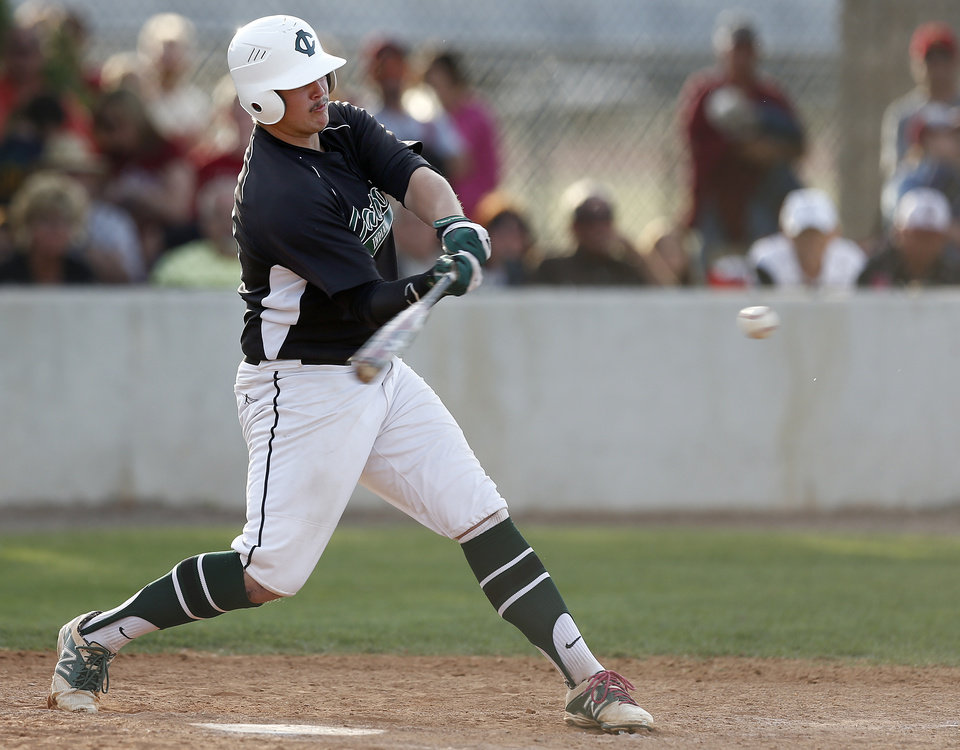Photo - Catoosa's Nick Brown makes a hit during the class 4A baseball game between Catoosa and Tuttle at Edmond Santa Fe High School in Edmond, Okla., Friday, May 16, 2014. Photo by Sarah Phipps, The Oklahoman