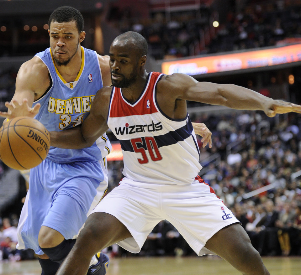 Washington Wizards center Emeka Okafor (50) works for the ball against Denver Nuggets center JaVale McGee (34) during the second half of an NBA basketball game, Friday, Feb. 22, 2013, in Washington. The Wizards won 119-113. (AP Photo/Nick Wass)