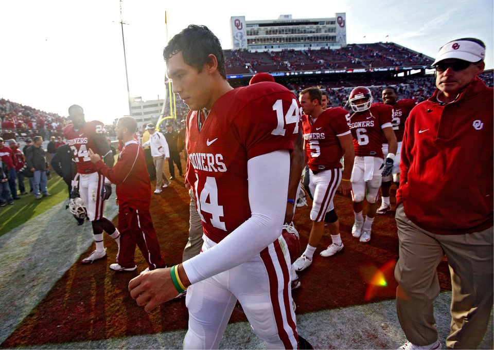 Photo - Oklahoma's Sam Bradford walks off the field after the 33-7 win over Baylor during the college football game between the University of Oklahoma Sooners (OU) and the Baylor University Bears at Gaylord Family-Oklahoma Memorial Stadium on Saturday, Oct. 10, 2009, in Norman, Okla. 
