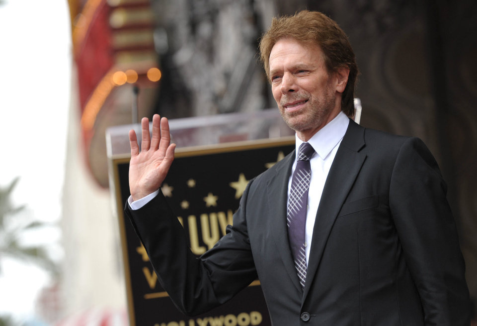 Photo - Film producer Jerry Bruckheimer waves to the crowd at his star ceremony on the Hollywood Walk of Fame on Monday, June 24, 2013 in Los Angeles. (Photo by John Shearer/Invision/AP) ORG XMIT: CAJS108
