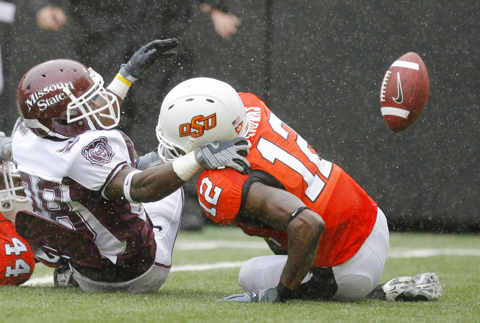 Photo - MSU Jeran Trotter watches a fumble bounce away as Johnny Thomas holds him down at the Oklahoma State University (OSU) football game against Missouri State University (MSU) Saturday Sept. 13, 2008 at Boone Pickens Stadium in Stillwater, Okla. OSU recovered. BY MATT STRASEN, THE OKLAHOMAN.