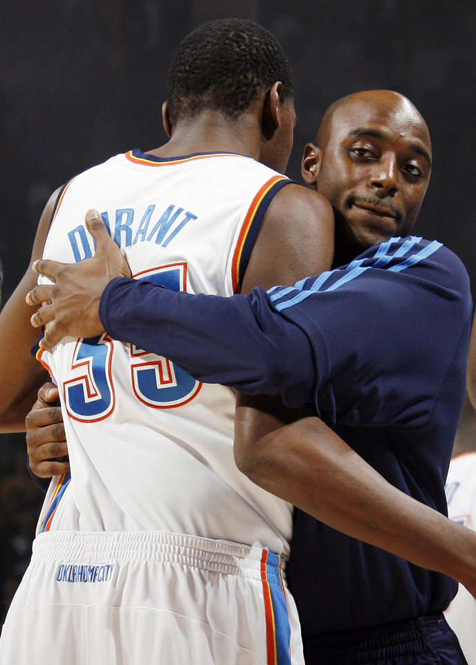 Photo - HUG: The Thunder's Damien Wilkins, right, hugs Kevin Durant as part of their pre-game ritual before the NBA basketball game between the Oklahoma City Thunder and the Boston Celtics at the Ford Center in Oklahoma City, Wednesday, Nov. 5, 2008. BY NATE BILLINGS, THE OKLAHOMAN ORG XMIT: KOD