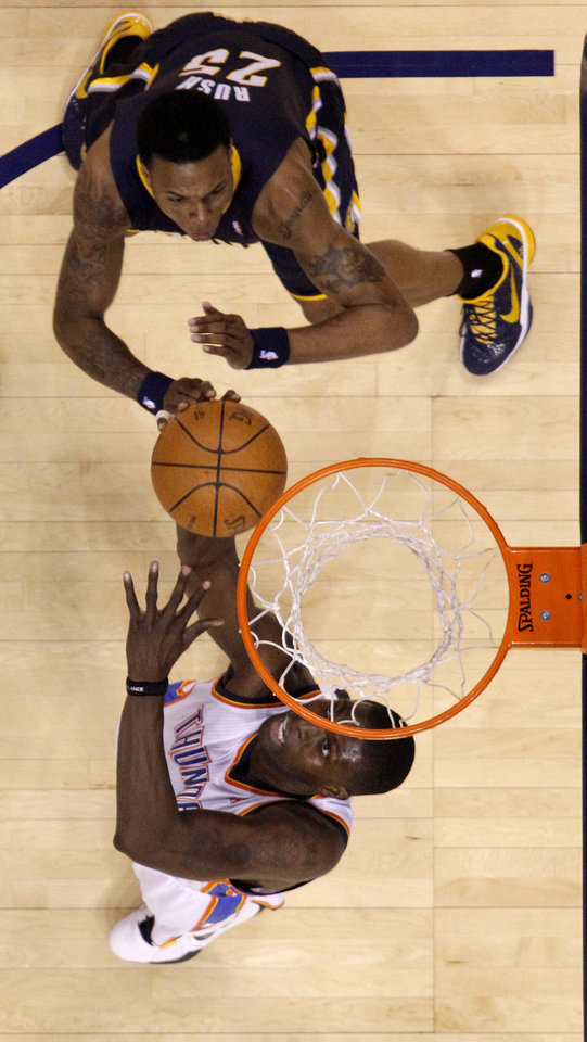 Oklahoma City\'s Nazr Mohammed (8) puts a shot up beside Indiana\'s Brandon Rush (25) during the NBA basketball game between the Oklahoma City Thunder and the Indiana Pacers at the Oklahoma City Arena, Wednesday, March 2, 2011. Photo by Bryan Terry, The Oklahoman