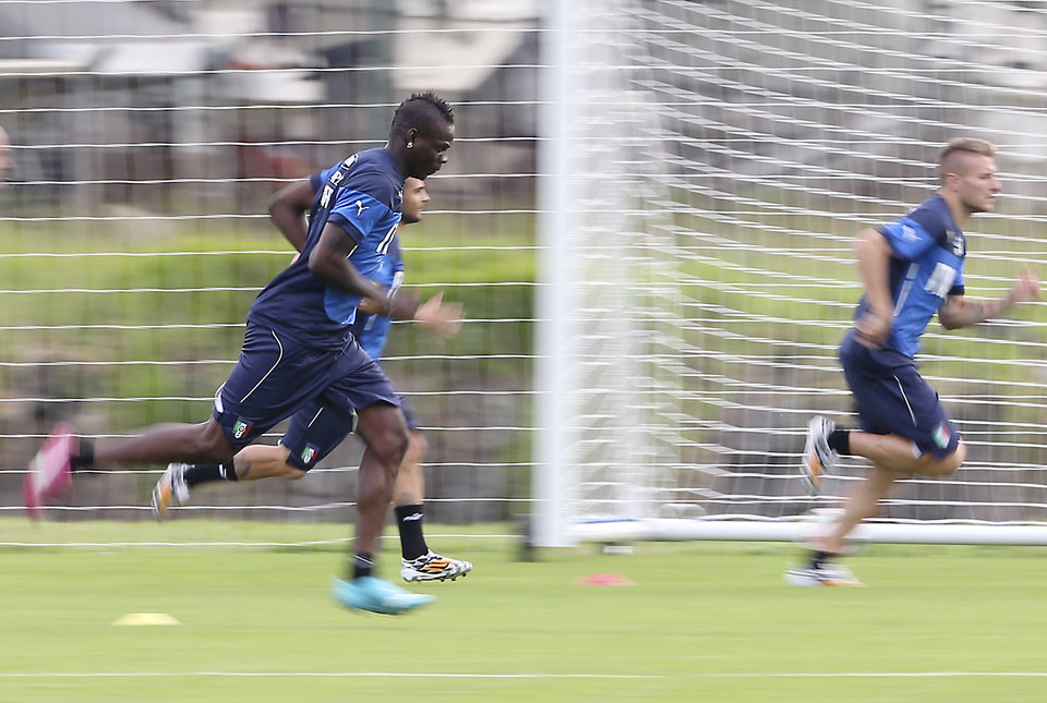 Photo - Italy forward Mario Balotelli, left front, forward Lorenzo Insigne and forward Ciro Immobile, right, run sprints during a training session for the upcoming World Cup at the Portobello training center in Mangaratiba, Brazil, Friday, June 6, 2014. Italy is part of Group D that includes Costa Rica, England and Uruguay. Italy will play England in Manaus in its opening match on June 14. (AP Photo/Antonio Calanni)