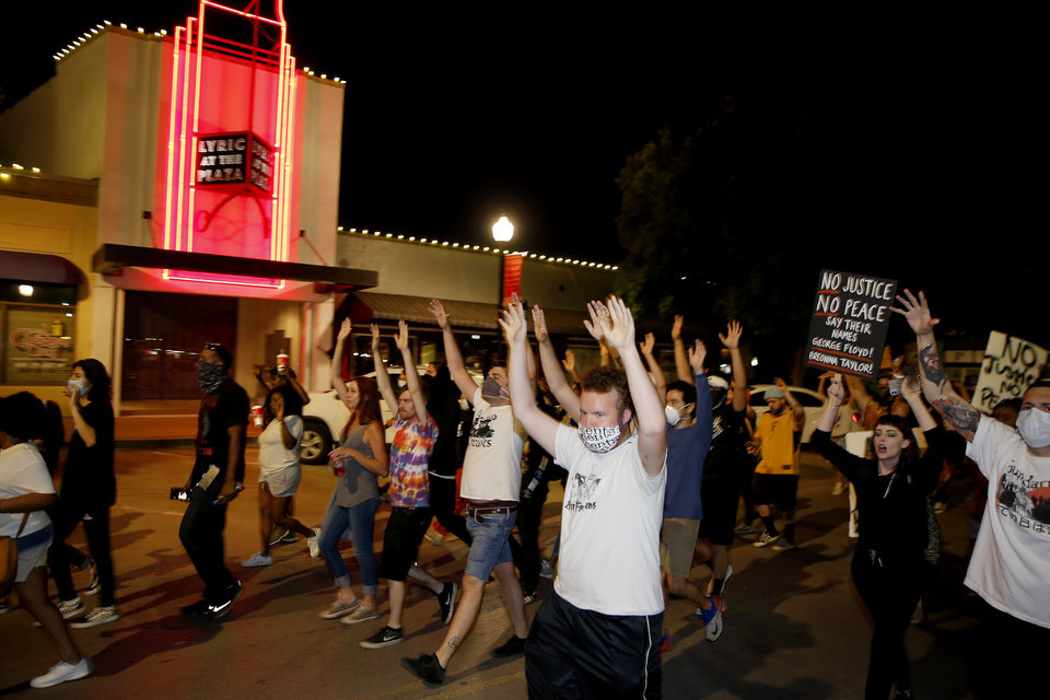 Photo - Protesters march west on NW 16 in Oklahoma City, Saturday, May 30, 2020. The protest was in response to the death of George Floyd. [Bryan Terry/The Oklahoman]