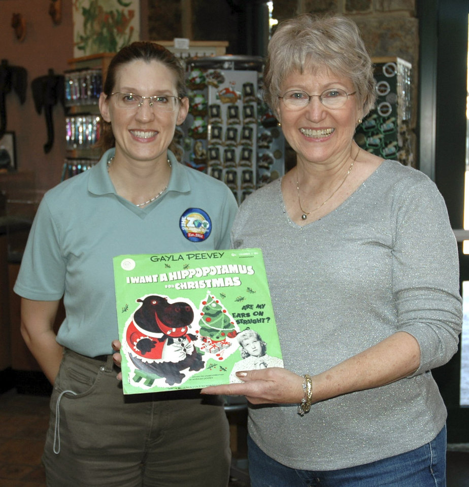 Photo - Zoo naturalist and historian Amy Stephens, left, stands with Gayla Peevey at the Oklahoma City Zoo. Peevey, now 65, sang the hit song