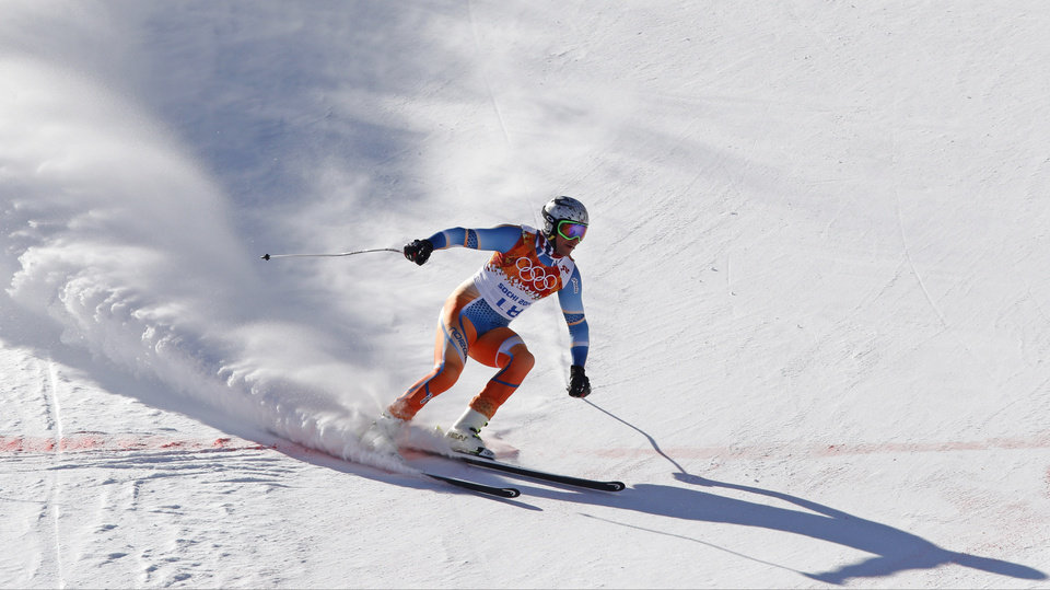 Photo - Norway's Aksel Lund Svindal comes to a halt at the end of a men's downhill training run for the Sochi 2014 Winter Olympics, Saturday, Feb. 8, 2014, in Krasnaya Polyana, Russia. (AP Photo/Christophe Ena)