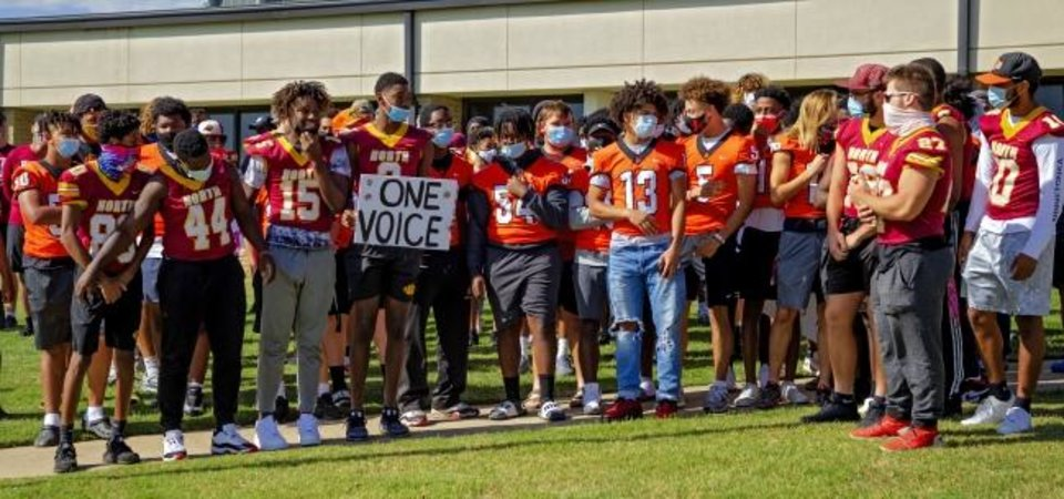 Photo -  Students, coaches and parents from Putnam City's three high schools – Putnam City, Putnam North and Putnam West – gathered Monday at the district's administration building asking why sports were suspended. [Chris Landsberger/The Oklahoman]
