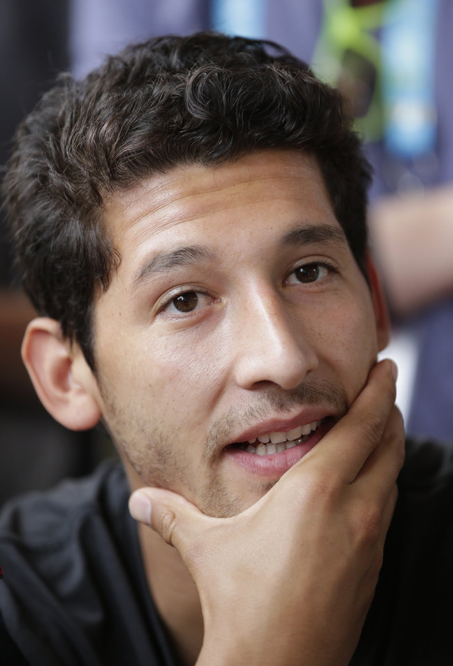 Photo - United States' Omar Gonzalez talks to reporters before a training session in Sao Paulo, Brazil, Saturday, June 28, 2014. The U.S. will play against Belgium on Tuesday, July 1, in the round 16 of the 2014 soccer World Cup. (AP Photo/Julio Cortez)