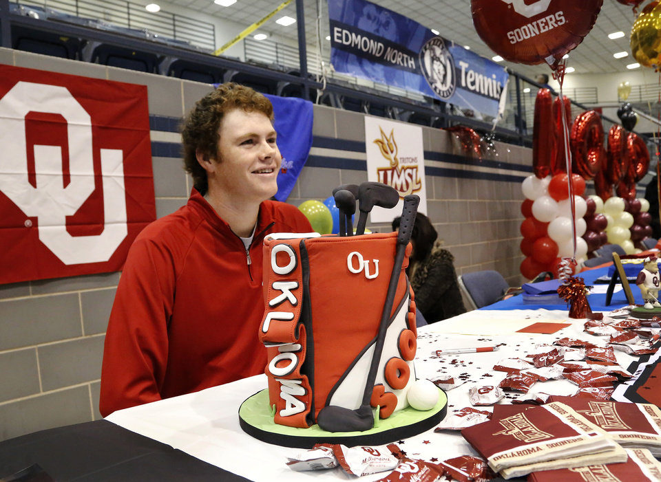 Golfer Griffin Pierce in front of his cake shaped like a golf bag. Athletes from Edmond North High School signed national letters of intent with colleges and universities during a ceremony in the school's gymnasium Wednesday morning, Nov. 13, 2013. Various sports include golf, softball, wrestling,  lacrosse and others. Photo by Jim Beckel, The Oklahoman