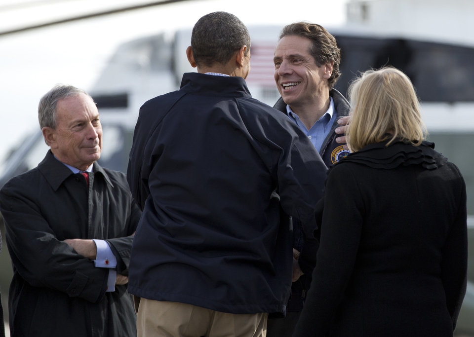 <p>President Barack Obama, accompanied by Sen. Kirsten Gillibrand, D-N.Y., right, is greeted by New York Gov. Andrew Cuomo, second from right, and New York Mayor City Michael Bloomberg as he arrives at JFK International Airport in New York, Thursday, Nov. 15, 2012, en route to visit areas devastated by Superstorm Sandy. (AP Photo/Carolyn Kaster)</p>